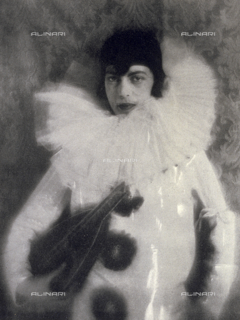 Portrait of a young man in Pierrot costume