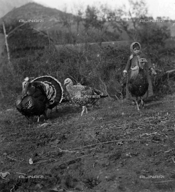 Portrait of a young peasant with turkeys