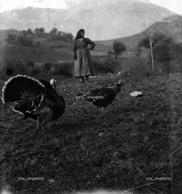 Portrait of a peasant with turkeys