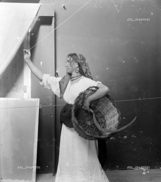 Model posing holding a sickle and a basket