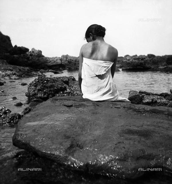 Female nude on the rocks