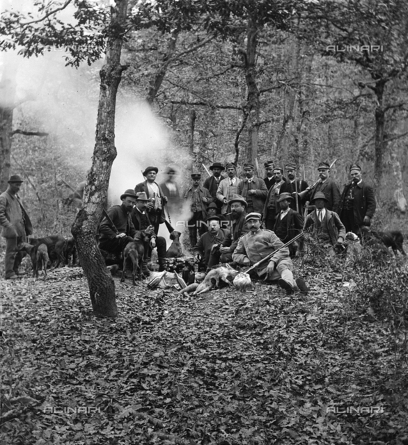 Group of hunters with their dogs in the wood