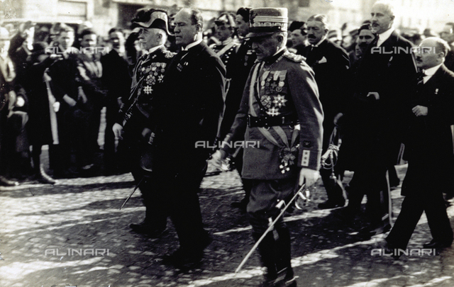 Benito Mussolini, marshal Diaz and admiral Thaon di Revel passing through the crowd during an official ceremony
