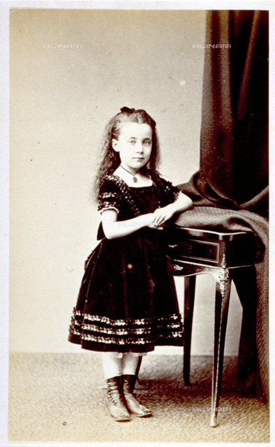 Portrait of small girl in elegant clothes
