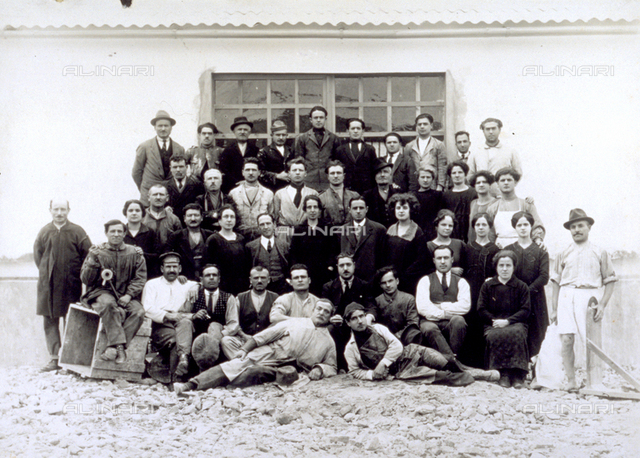 Portrait of a group of men and women in work clothes