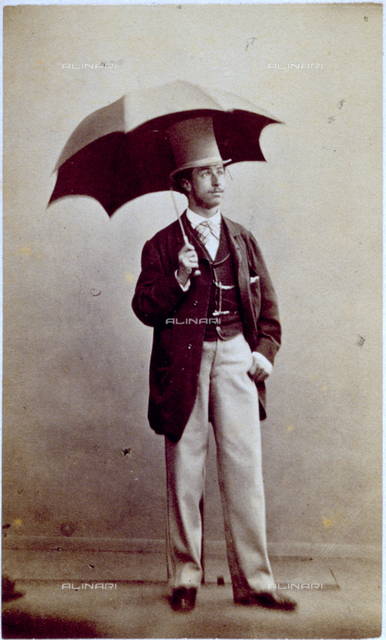 Full-length portrait of a man in elegant clothes, with top hat and open umbrella