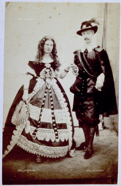 Full-length portrait of a man and woman in fancy dress costume