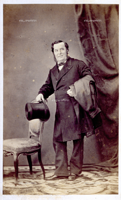 Full-length portrait of the singer Antonio Tamburini. The man wears a frock coat and holds a top hat