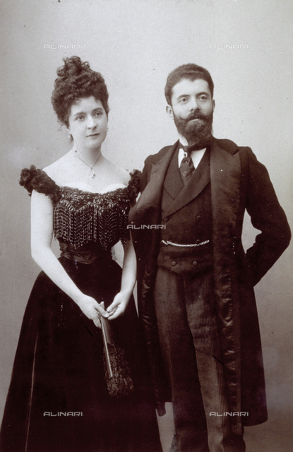 Full-length portrait of a young couple in evening clothes