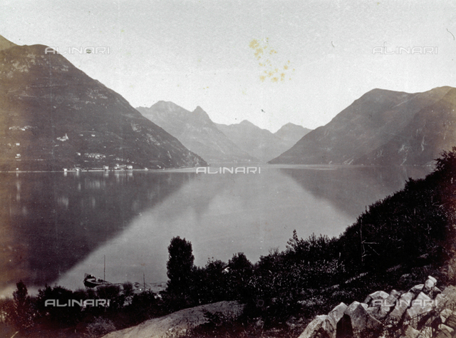 The lake of Como, with the mountains surrounding the lake reflected in the water