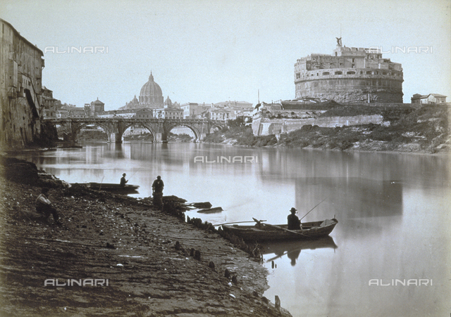 View of Castel Sant'Angelo and the Bridge of Sant'Angelo, taken from the lungotevere in Rome. In the foreground a group of fishermen and their boats