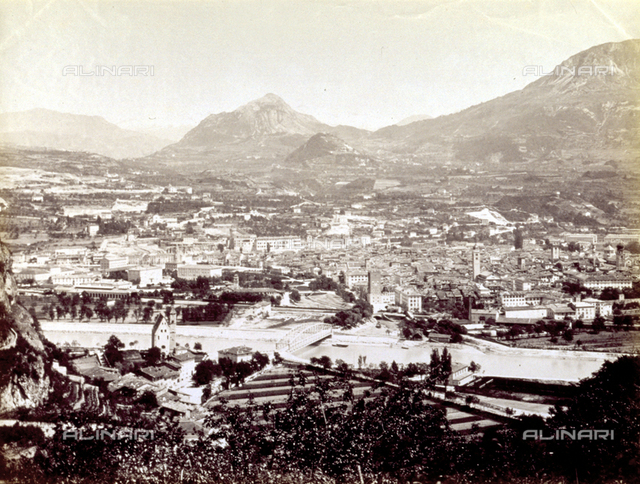 Panorama of the city of Trento, seen from above. In the foreground the Adige river, in the background the mountains