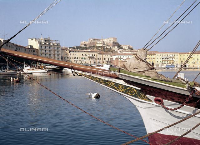 View of the port of Portoferraio. In the foreground the prow of a boat