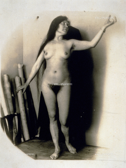 Full-length portrait of a young nude woman in a 'sculptural pose'