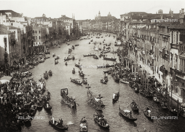 View from above of the Grand Canal in Venice during a historical regatta. The canal is crowded with gondolas