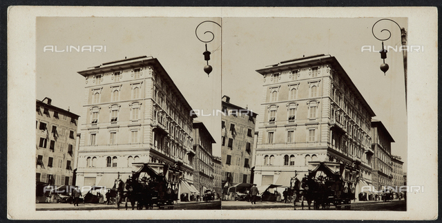A few buildings in Genoa with a carriage in the foreground