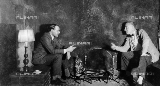 Antonio Maraini and Gio Ponti by a fireplace in Torre di Sopra, Florence