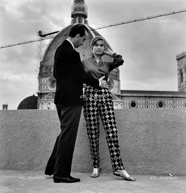 The brand-maker and stylist Emilio Pucci with a model on the terrace of Palazzo Pucci in Florence