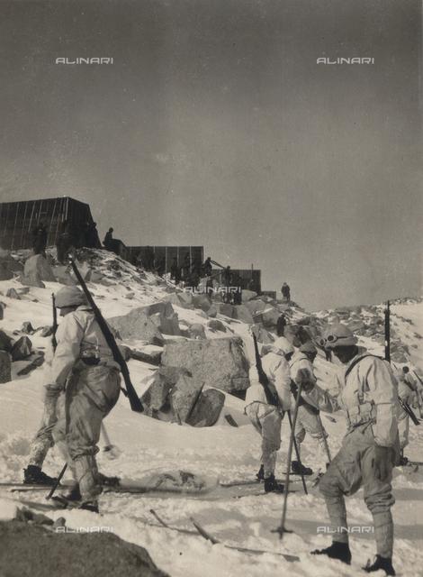 "Album ""R. Esercito I G. M. (Prima Guerra Mondiale)"": Skiers at the Rifugio Garibaldi"