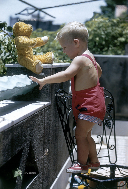 Little boy with teddy bear; America
