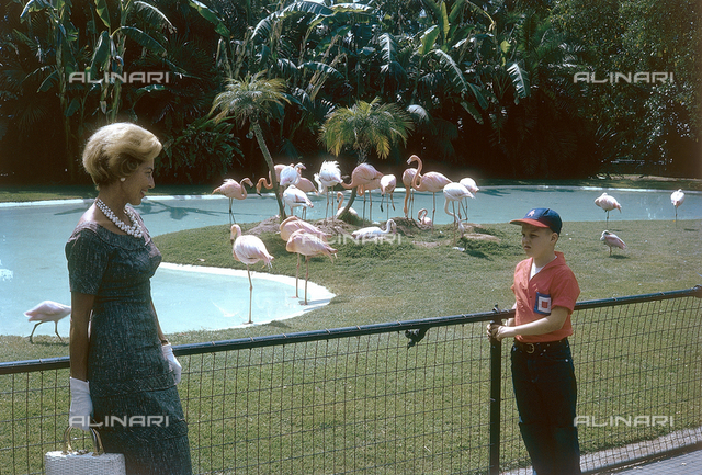 Mother with her son at a zoo; America