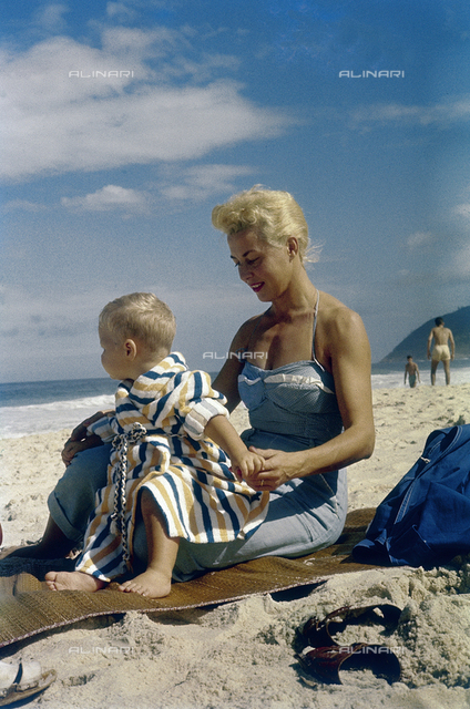 Mother with her baby on the beach; America