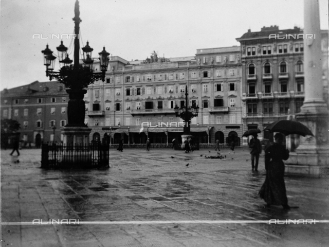View of Piazza Unità d'Italy with Stratti building, model building and the Café of Mirrors in Trieste. Reproduction of a photo