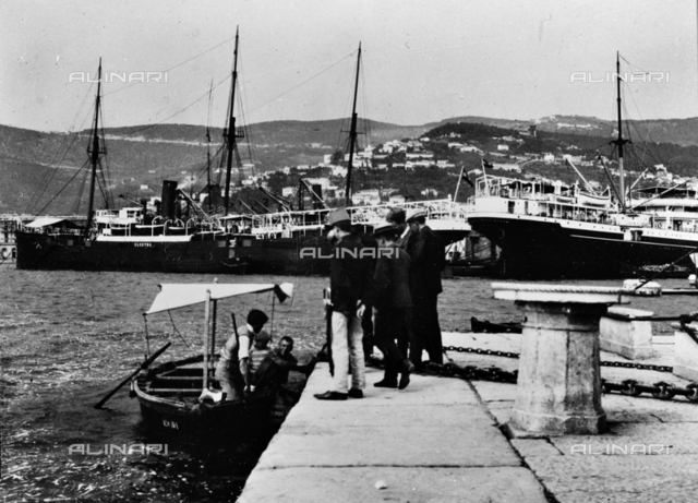 Group of men on the pier of the port of Trieste