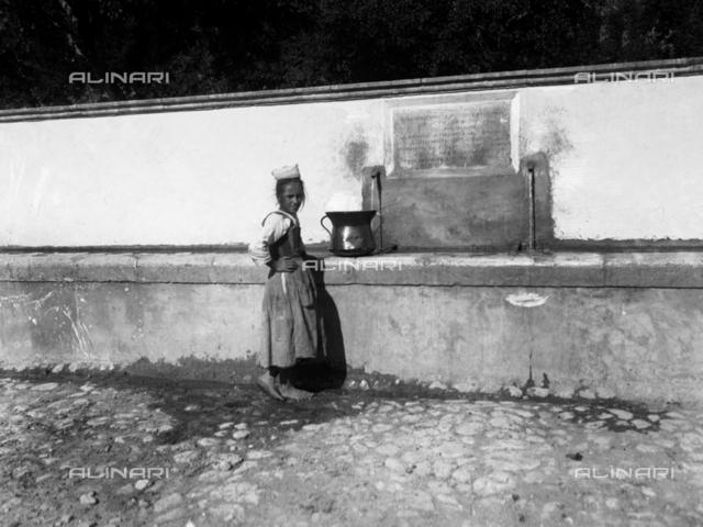 Youth at a fountain, Camarda, L'Aquila