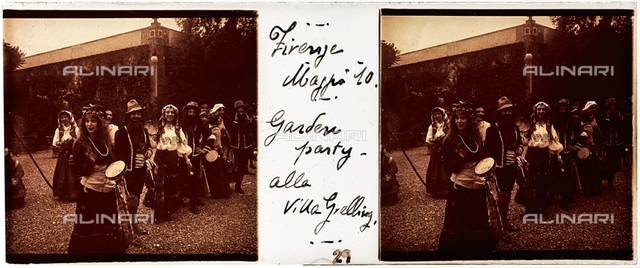 People in traditional dress at a party in the garden of Villa Grelling, Florence; stereoscopic image
