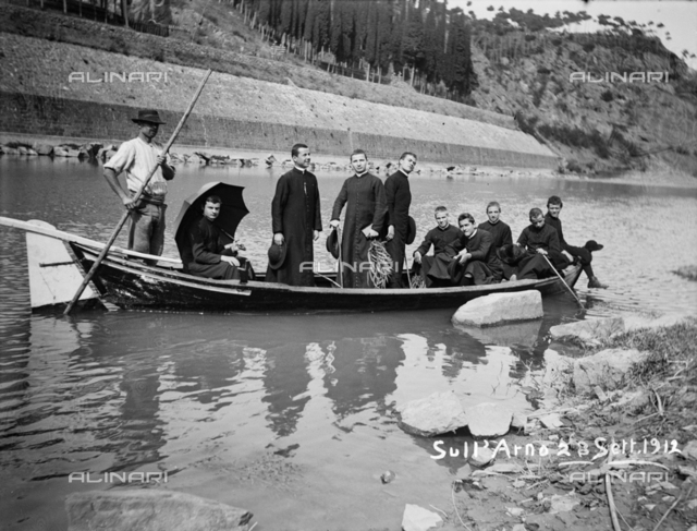 Young priests and seminarians on a boat during a trip on Arno