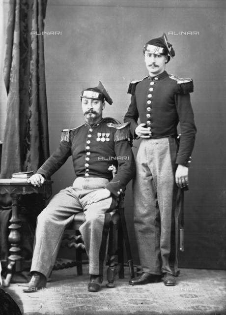 Roman noblemen in military uniform posing in a studio photo