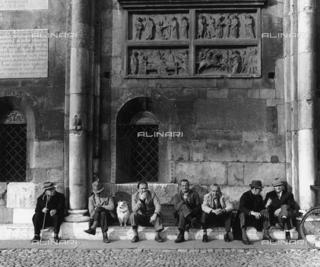 Group of pensioners in front of the Duomo di Modena
