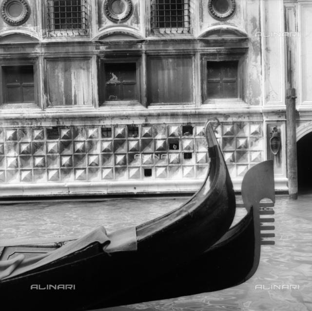 Step gondola in a Venetian canal