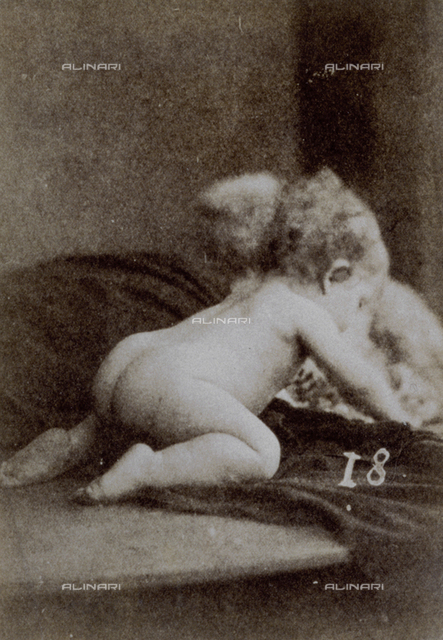 Full-length portrait of a nude child crawling