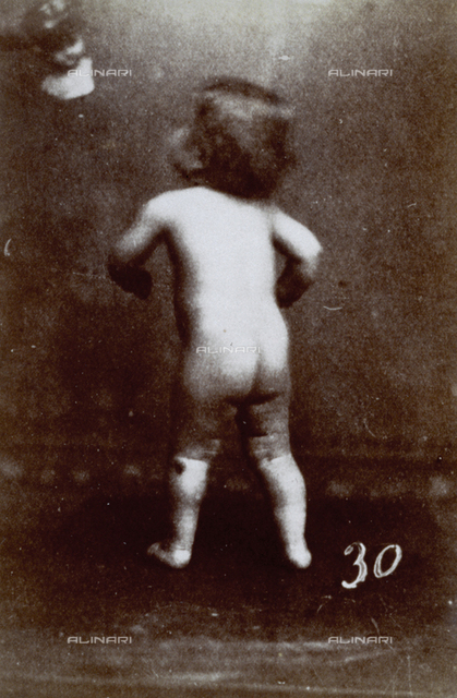 Portrait of a nude child from the back