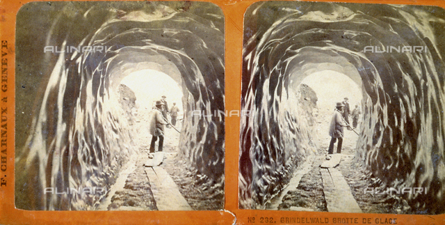 View of a pass through a tunnel of ice; three men are outside