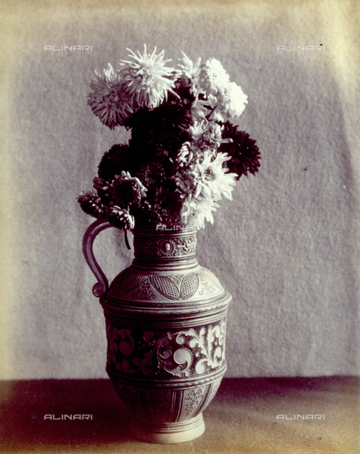 A bunch of dahlias in a pitcher