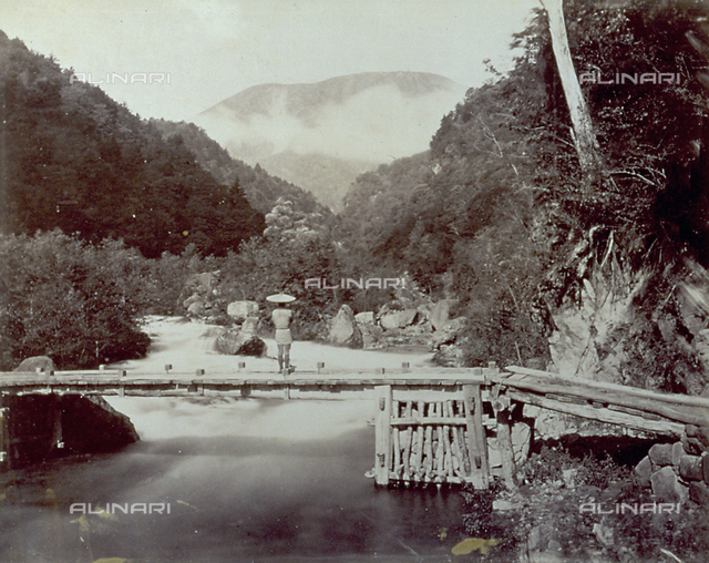 Wooden bridge built over a river on the road that leads to Fuzenji in Japan