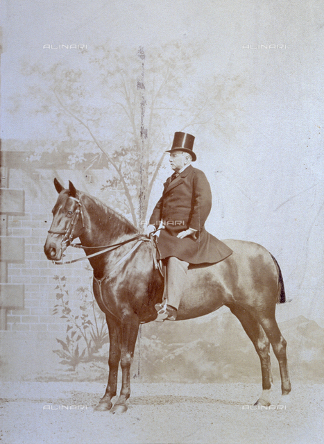 Full length portrait , in profile, of an elderly man on horseback in elegant riding clothes and top hat