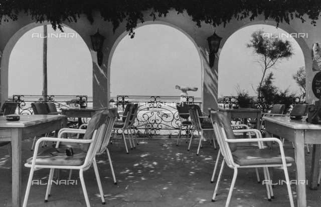 """""""Benches"""": chairs and tables under a portico on the Black Sea"""
