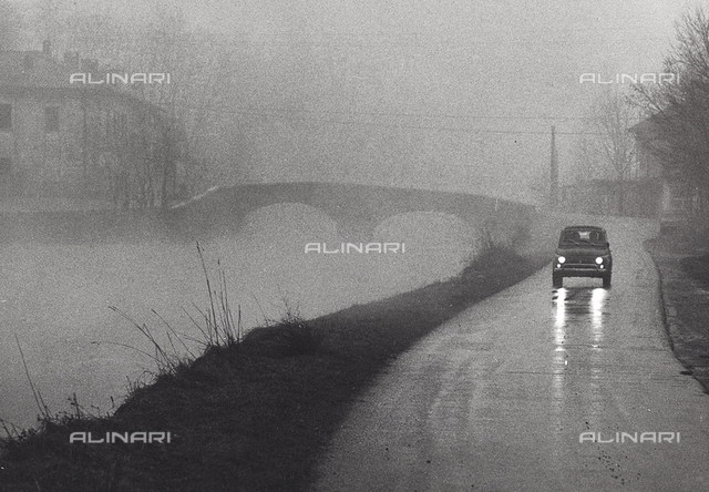 View of a village in the fog with car