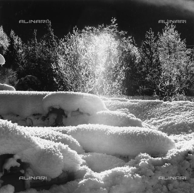 Plays of light and shade in the snow, in Valle dell'Engadina, in Switzerland