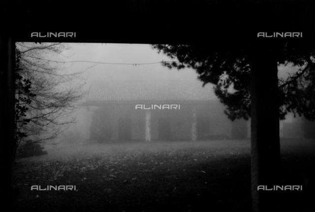House in fog in Livigno, Sondrio