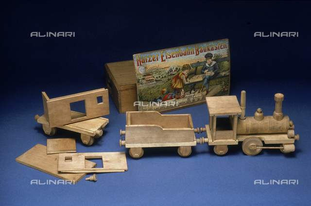 Wooden toy train with its assembly box