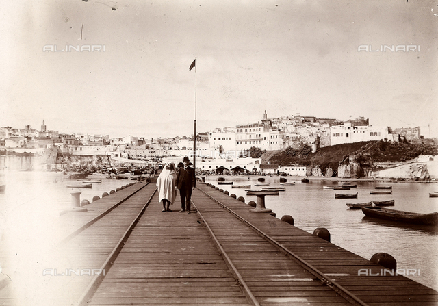 A couple on the pier of the port of Tangier.
