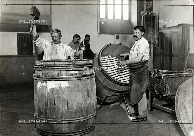 A few men at work at the tobacco factory.