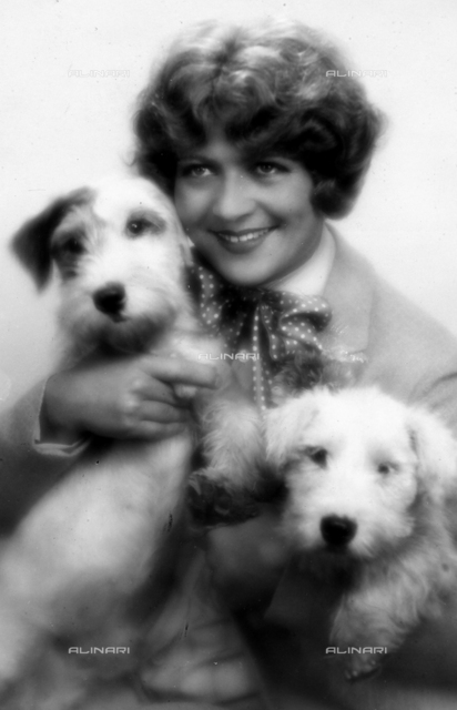 Portrait of the actress Diana with her two dogs.