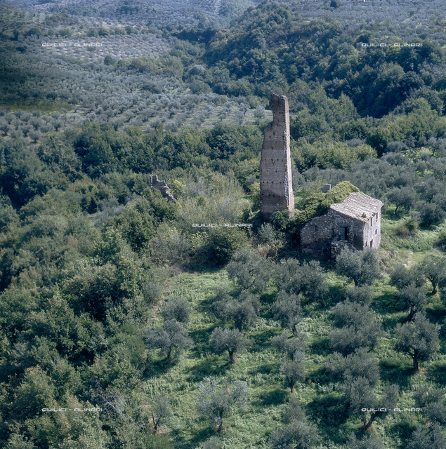 Aerial view of the land around Viterbo with a tower in ruins