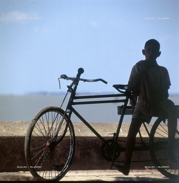 Portrait of a man with a bicycle, western State of Bengala